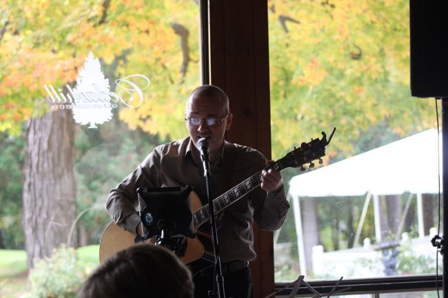 Dave Milliken singing at the wedding of Danielle Bisson