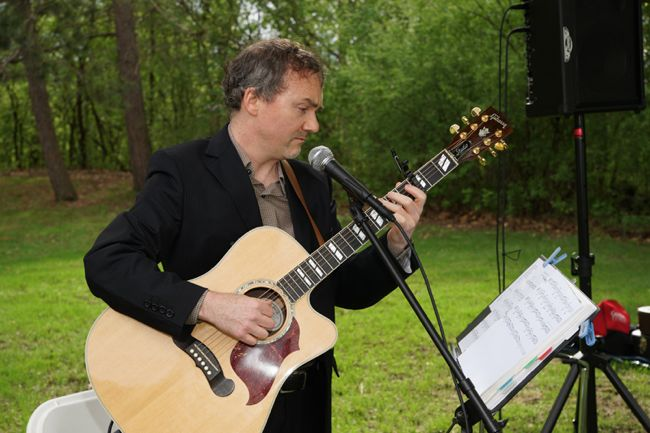 Dave Milliken performs at Saba Chez Wedding Ceremony