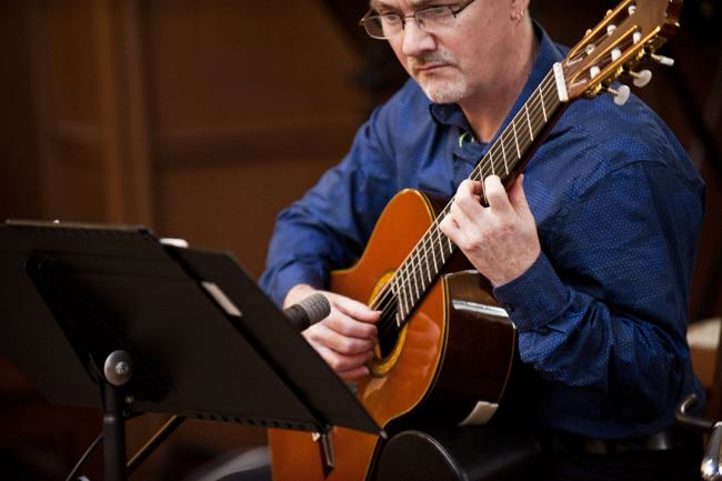 Dave Milliken plays classical guitar at the wedding of Karla Fraser